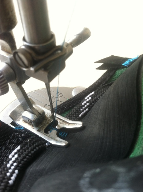 Stitching new laces in.