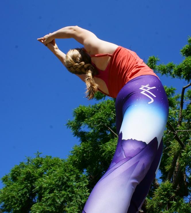 SFT leggings during a springtime yoga session.